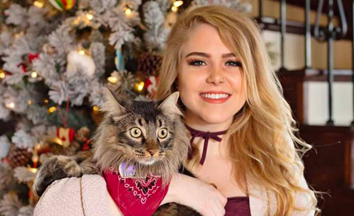 Bella and her cat Benz, who was adopted from Operation Kindness, North Texas No-Kill Animal Shelter